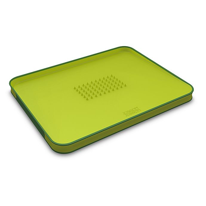 Alternate image 1 for Joseph Joseph® Cut&Carve™ Large Plus Multi-Function Chopping Board in Green