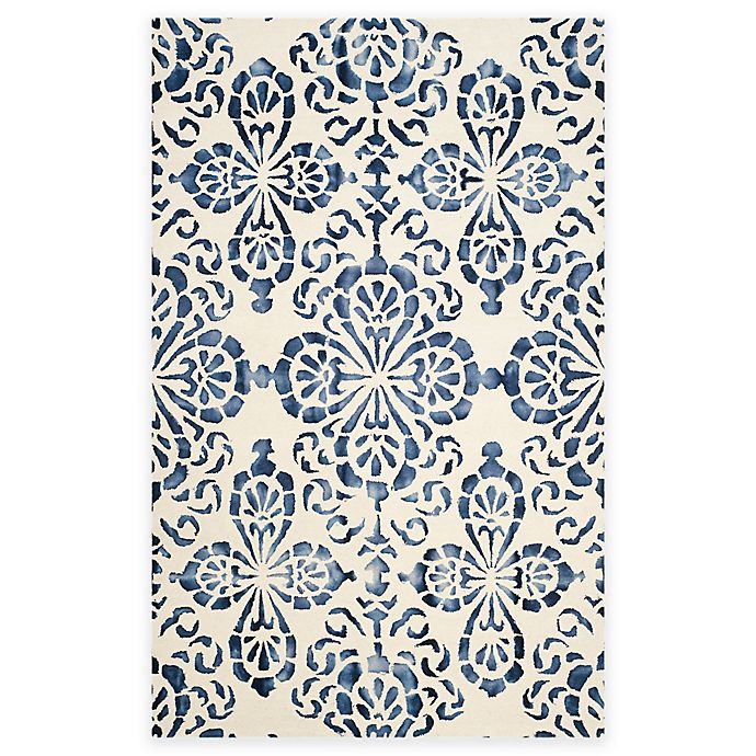 Alternate image 1 for Safavieh Dip Dye Floral Medallion 4-Foot x 6-Foot Hand-Tufted Wool Area Rug in Ivory/Navy