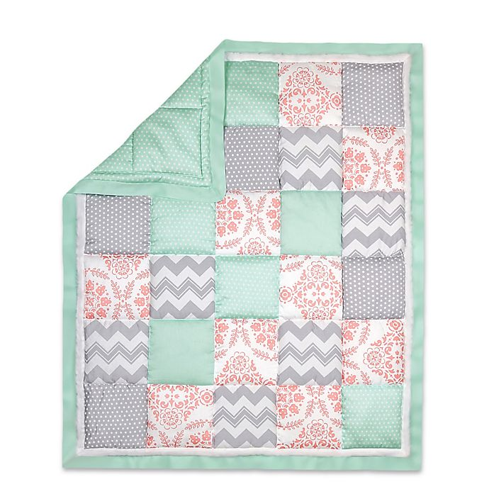 Alternate image 1 for The Peanut Shell® Dot Patchwork Quilt in Coral/Mint
