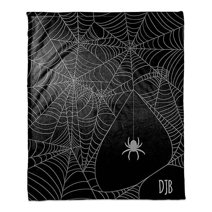 Alternate image 1 for Halloween Spider Webs Throw Blanket in Purple/Black