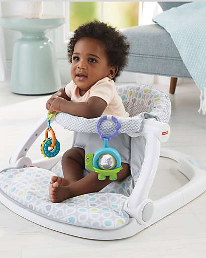 Fisher-Price® Sit-Me-Up Floor Seat folds flat for stow or go.