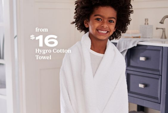 Child wrapped in Nestwell Hygro Cotton Towel - available exclusively at Bed Bath & Beyond starting at $10.