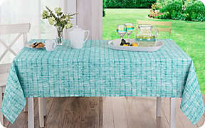 Set the scene with indoor/outdoor table linens.. Shop Now