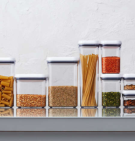 Organize your fridge and pantry with containers and bins.