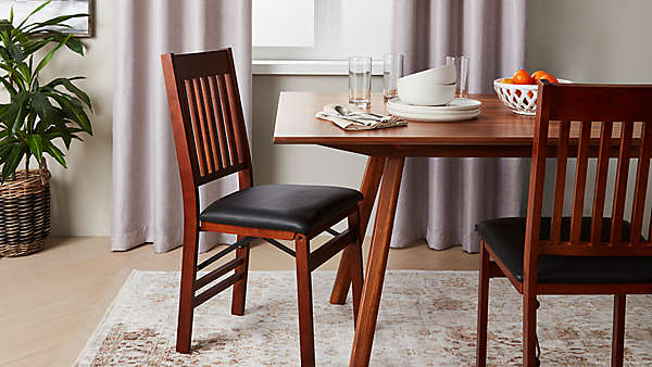 Folding tables and chairs to welcome in family.
