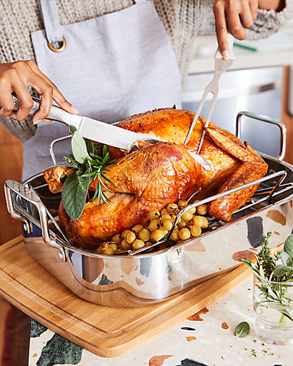 After the turkey rests, carve with a proper knife and cutting surface, and enjoy!