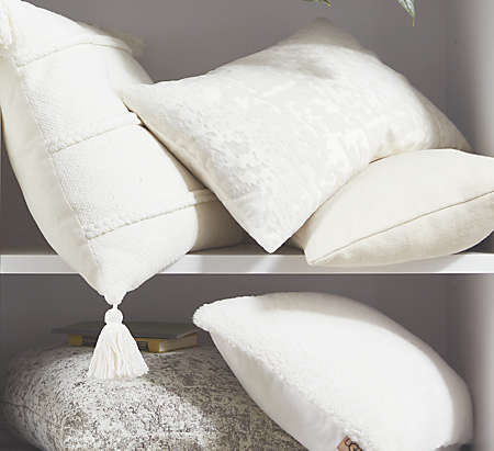 Throw pillows with textures and accents add dimension to the space.