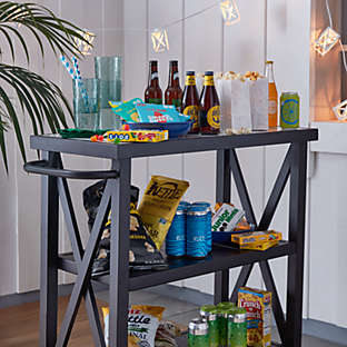 Roll out an outdoor-friendly bar cart that has space for it all.