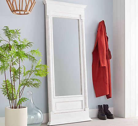 Set up a framed, full-length mirror.