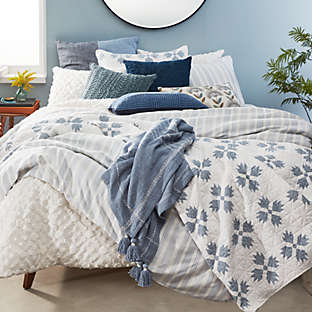Vintage-inspired bedding with a rustic, modern feel.
