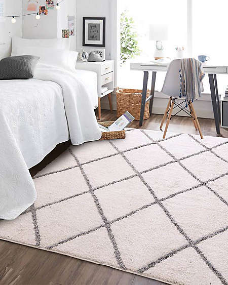 Sink your toes into a plush rug from Simply Essential™