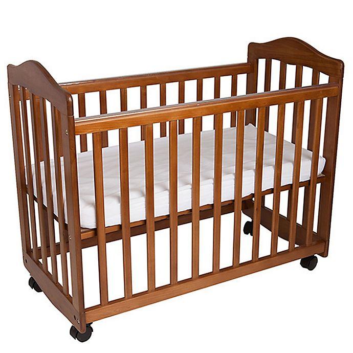 Alternate image 1 for LA Baby® The Original Bedside Manor Mini Crib in Pecan