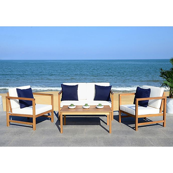 Alternate image 1 for Safavieh Montez 4-Piece Acacia Wood Conversation Set in Teak/Navy with Accent Pillows