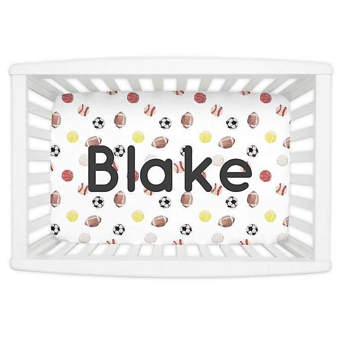 Alternate image 1 for Carousel Designs® Painted Sports Mini Fitted Crib Sheet